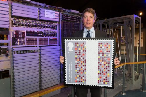 TNMOC Chairman Tim Reynolds with the Colossus stamp