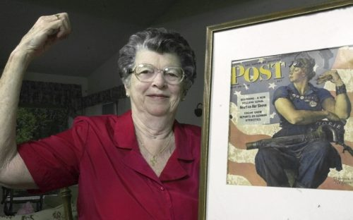 "FILE - In this May 22, 2002 file photo, Mary Doyle Keefe poses at her home in Nashua, N.H., with the May 29, 1943, cover of the Saturday Evening Post for which she had modeled as ""Rosie the Riveter"" in a Norman Rockwell painting. Keefe died Tuesday, April 21, 2015, in Simsbury, Conn., after a brief illness. She was 92. (AP Photo/Jim Cole, File)"