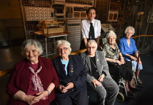 Colossus veterans left to right: Irene Dixon, Lorna Cockayne, Shirley Wheeldon, Joanna Chorley, Margaret Mortimer and standing Jacqui Garrad of TNMOC in front of Colossus Rebuild.