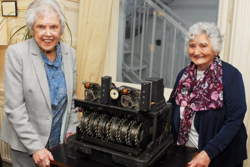 Colossus veterans, Betty O'Connell and Irene Dixon, get up close with a Lorenz SZ42 that sent messages that Colossus was designed to break.