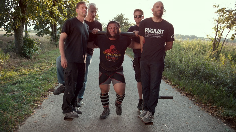 _NON EXCLUSIVE_ Patrik Baboumian (world record holding strongman) lifts film crew