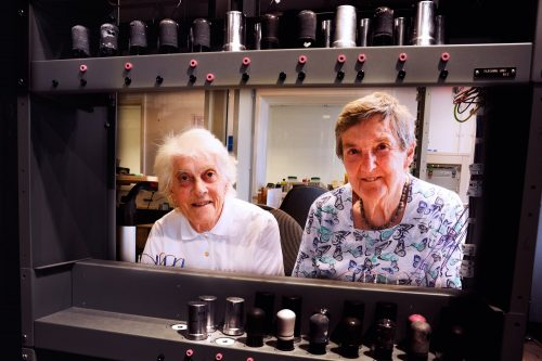 """Margaret Marrs and Joyce Wheeler inspecting the reconstruction of a computer they used seven decades ago. They think the new version is """"much too clean!""""."""