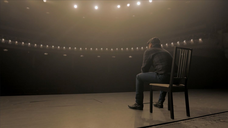 TUW_106_ERIC SITTING ON CHAIR FILM STILL
